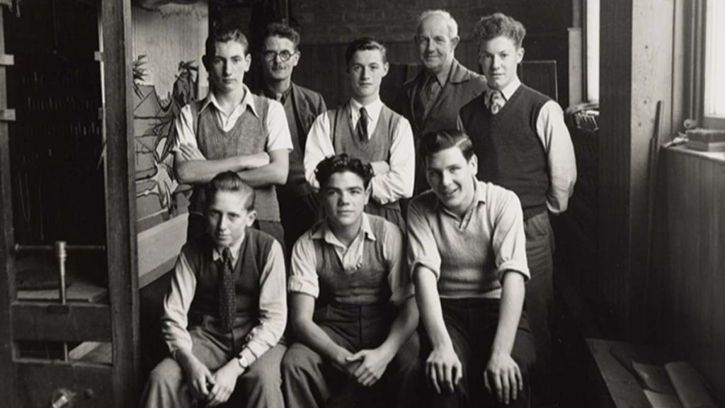 group photo of young men with shosrt hair, shirts and tank tops