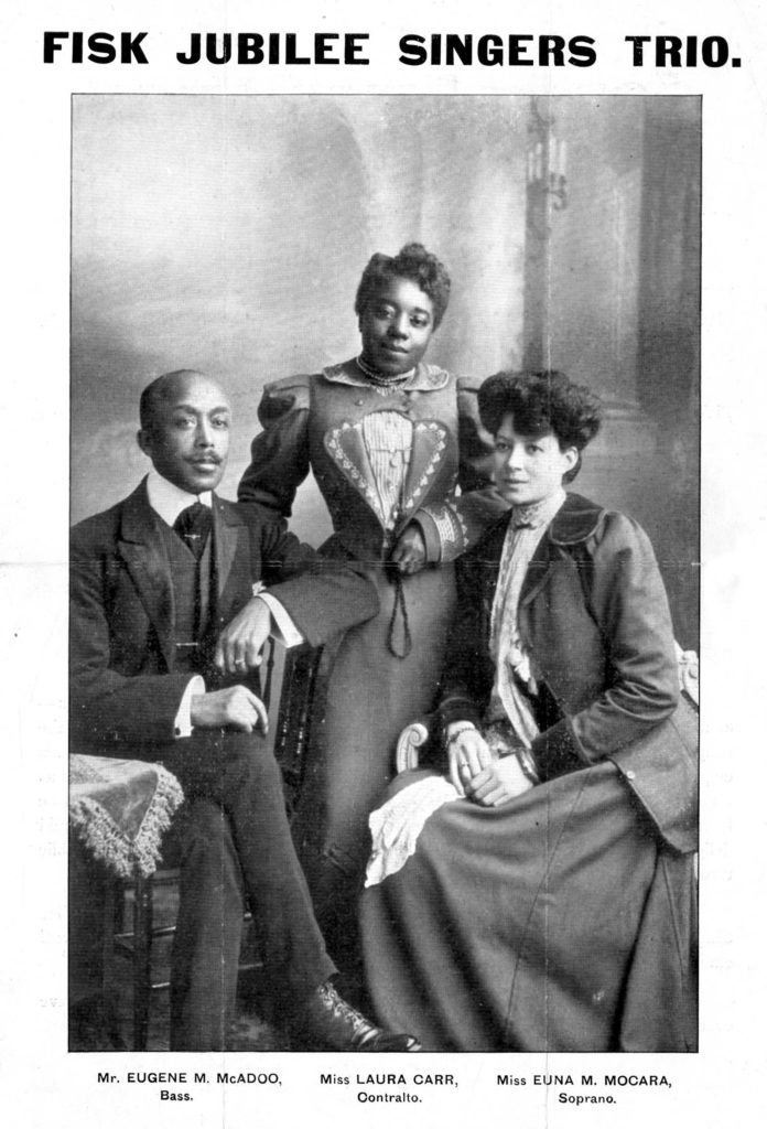studio portrait showing three Edwardian people - tow African American women and an African American man