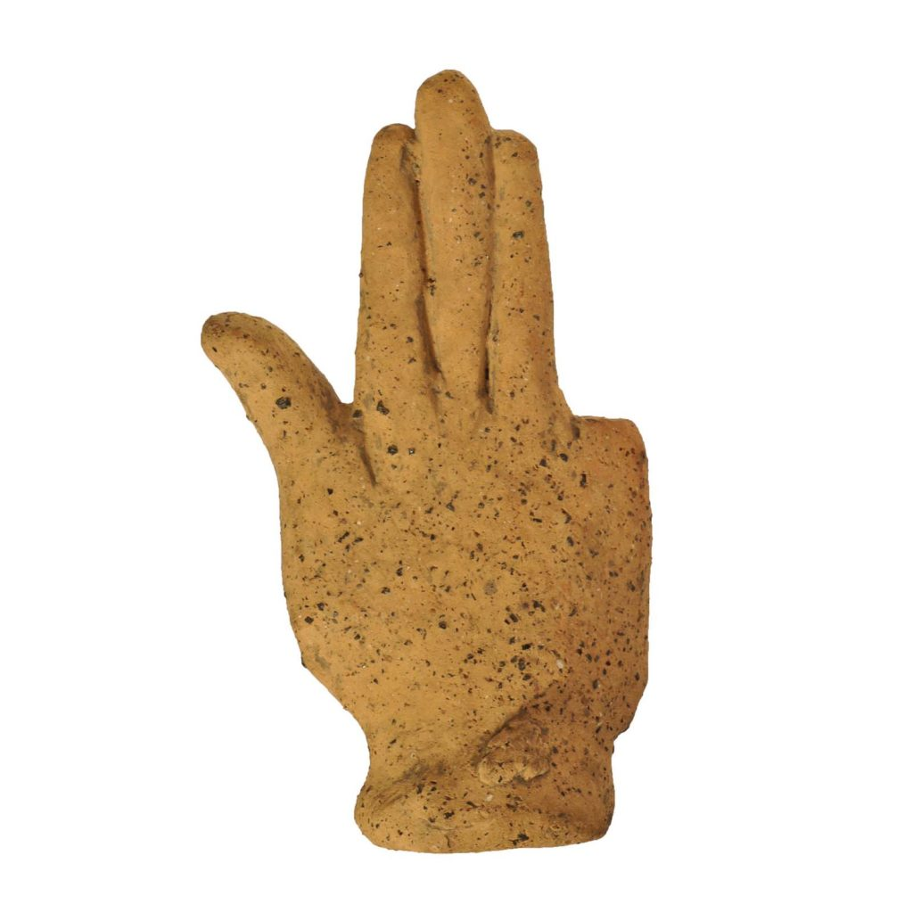 a terracotta cast of a hand with the thumb raised