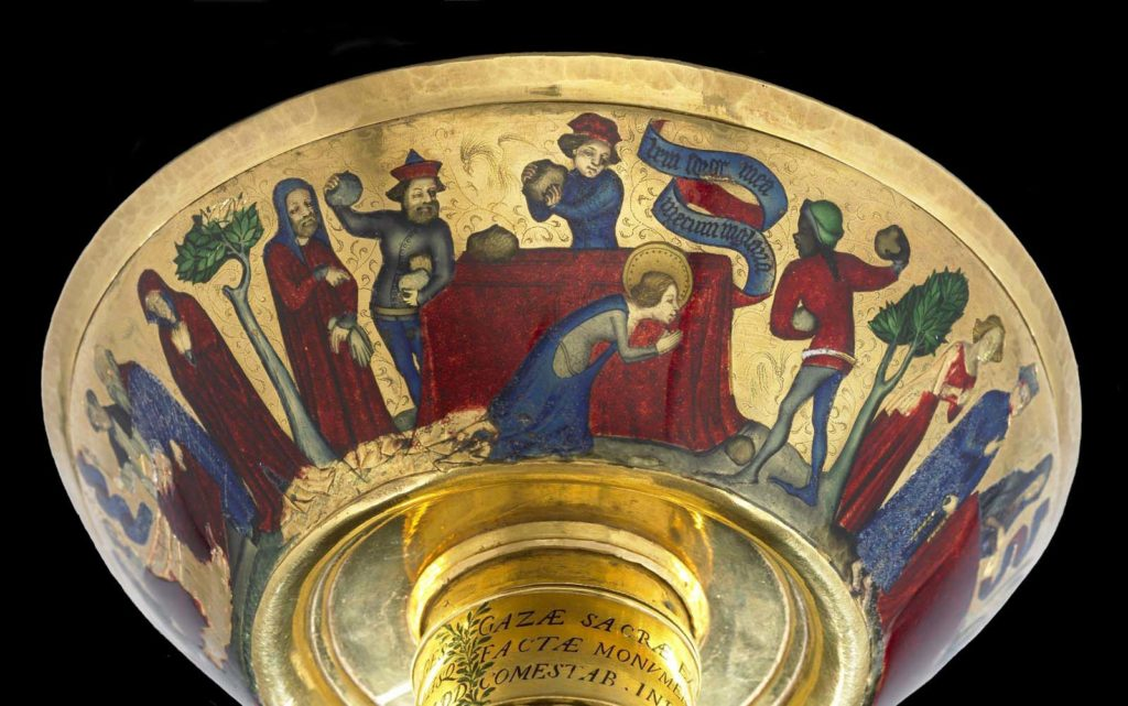 view of the underside of a gold cup with medieval figures