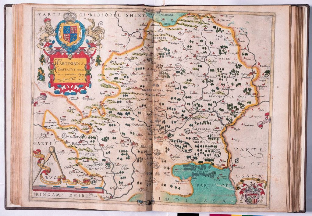 old coloured county map in a book