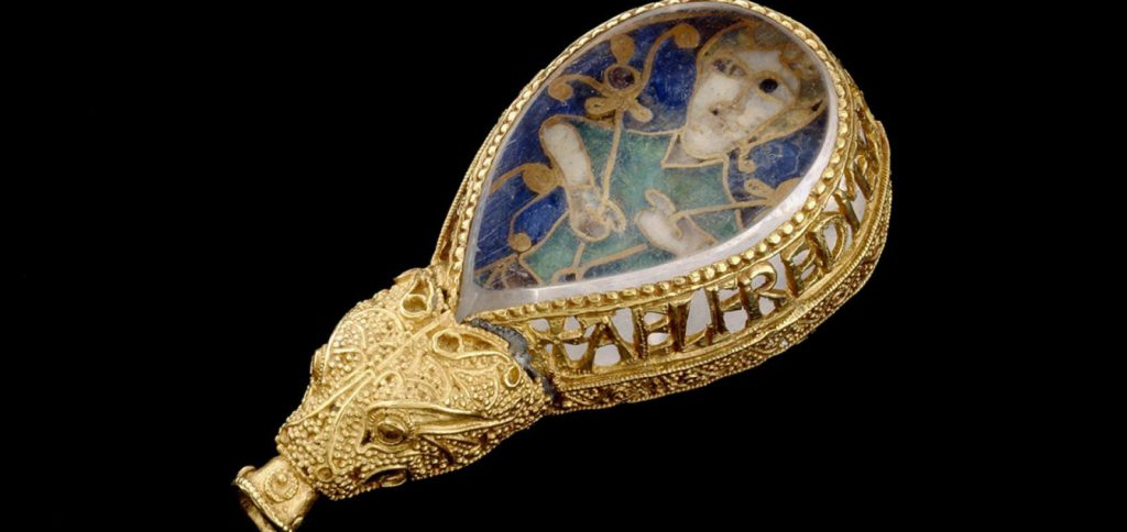 rock crystal in gold filigree surround with enamelled design of a figure behind