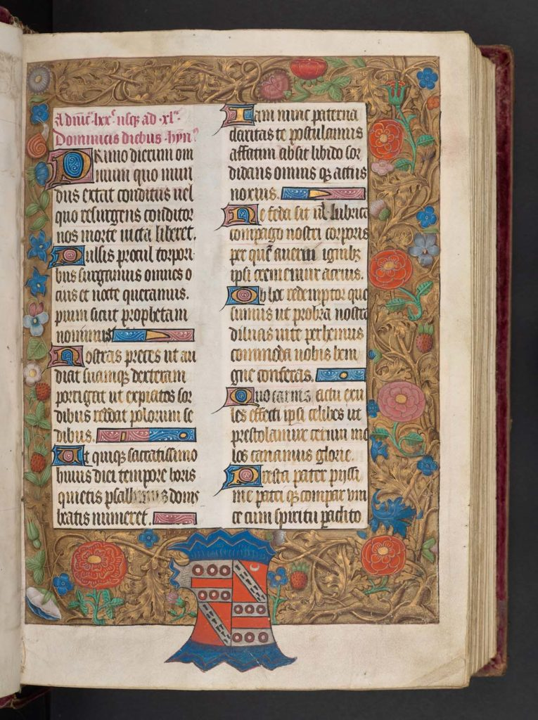 richy decorated medieval manuscript with tow columns of Gothic text and floral decoration