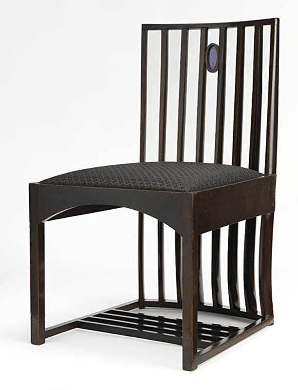 Charles Rennie Mackintosh designed chair with black upholstered seat and backrest in wooden columns