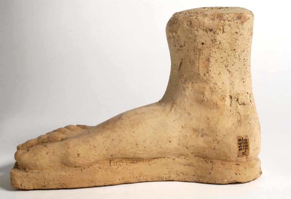 a large stone foot with Roman sandal