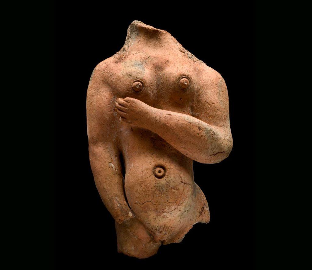 photo of female torso cast in terracotta