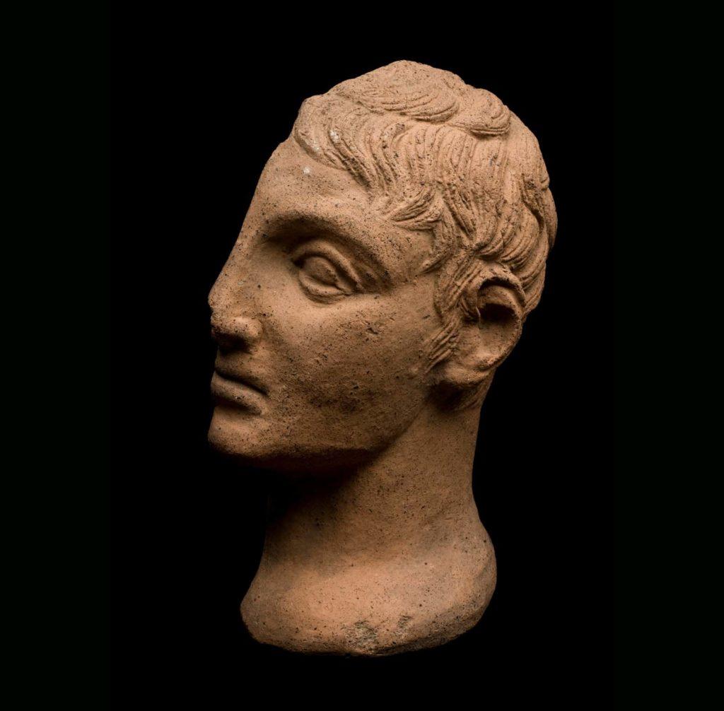 a cast of half a terracotta head