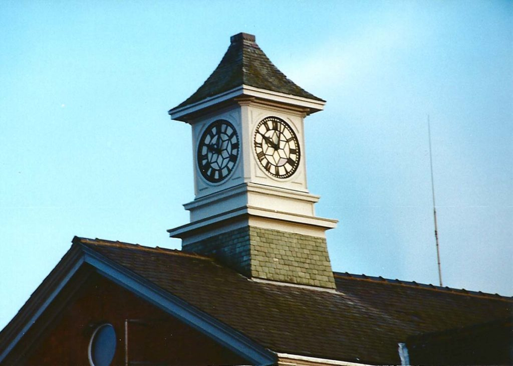 colour photo of a small clocktower on top of an apex roof
