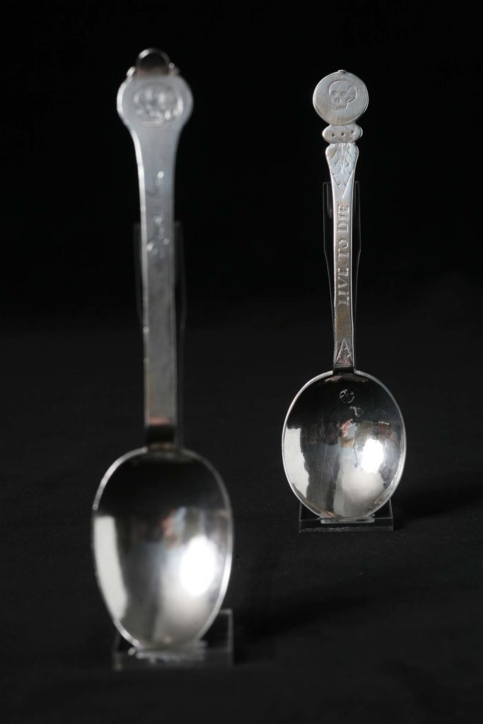 photo of apair of spoons with skulls on their handles