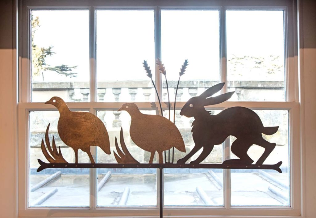 a photo of a hare and two birds made from metal