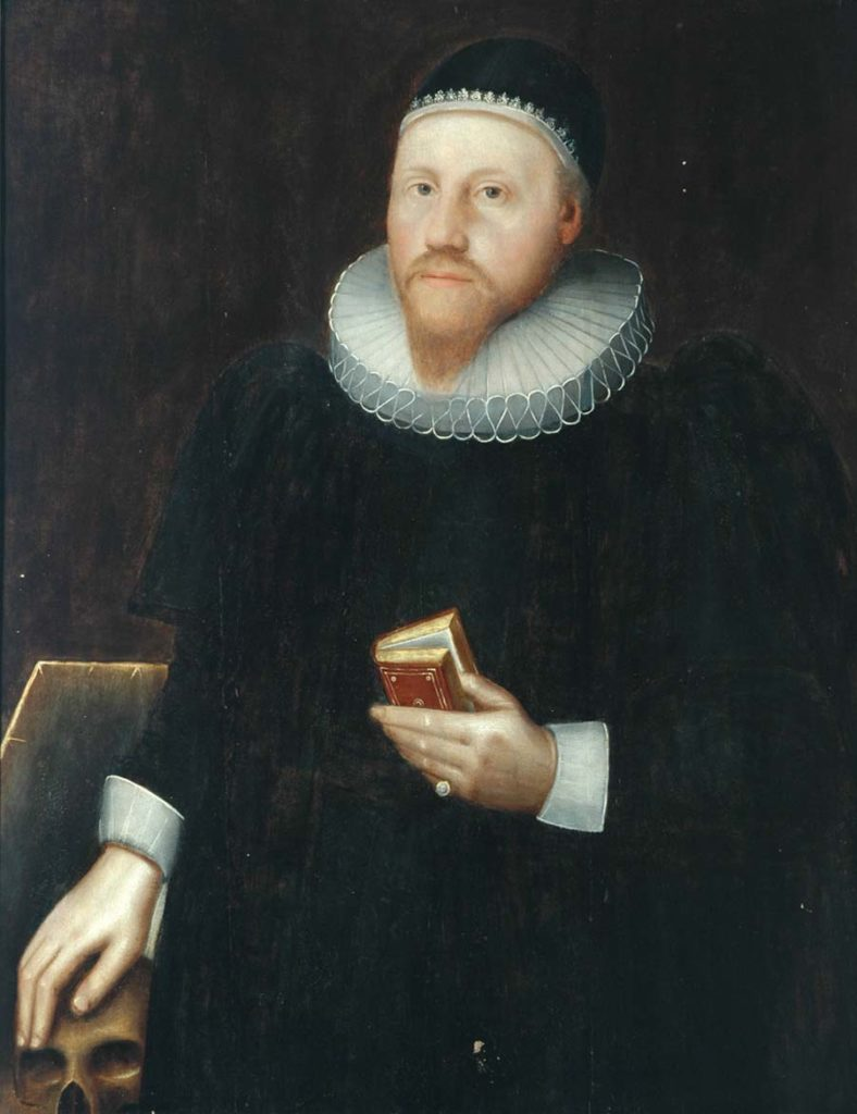photo of a seventeenth century gentleman with hand resting on a skull