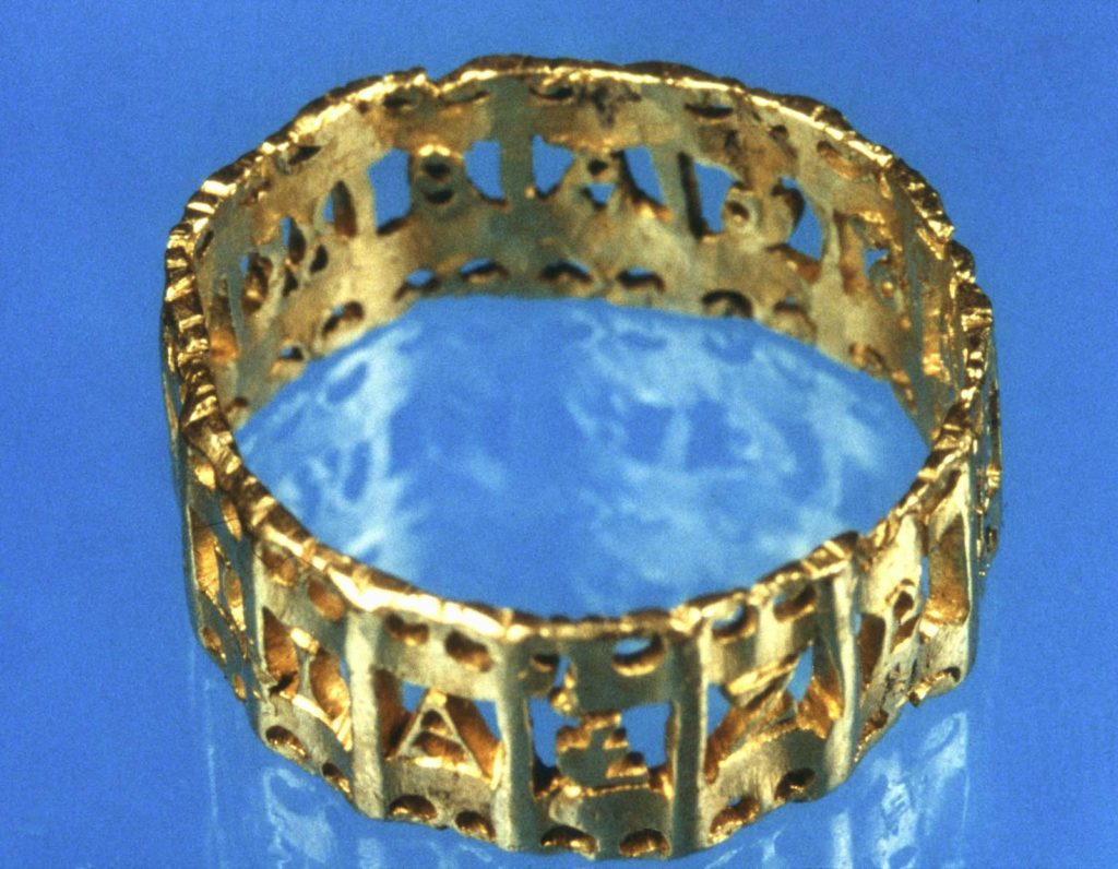 a gold finger ring with inscription