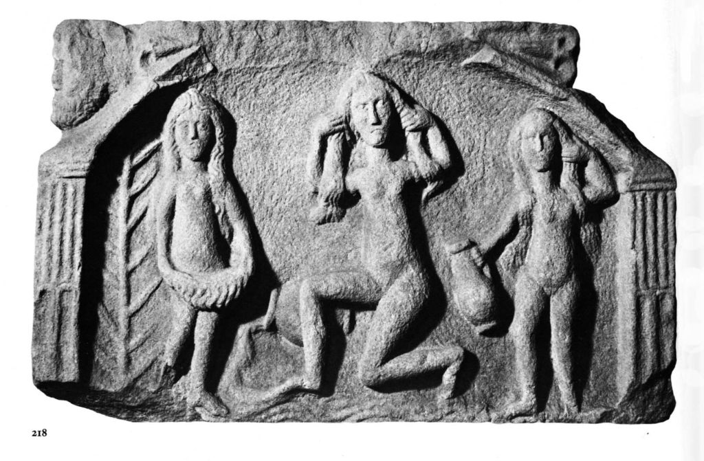 an relief sculpture showing Venus bathing with two attendants