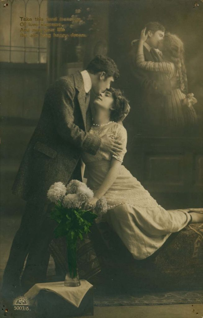 Edwardian card showing a couple kissing