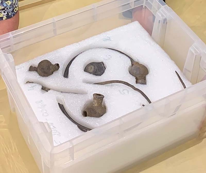 photo of metal objects in a foam bed inside a plastic box