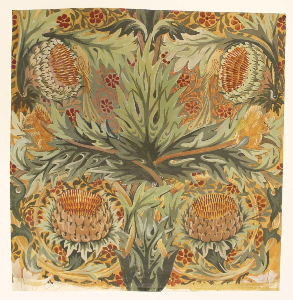textile pattern of green leaves against a bronze and rust background