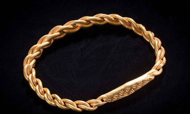 photo of a woven gold bracelet