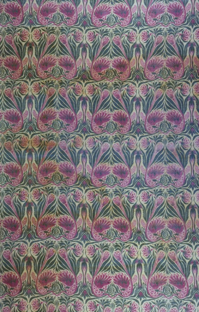 a repeating symmetrical peacock pattern in turqoiuse and purple