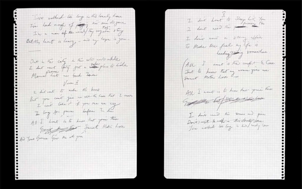 a photo of two pages of handwritten lyrics on graph paper