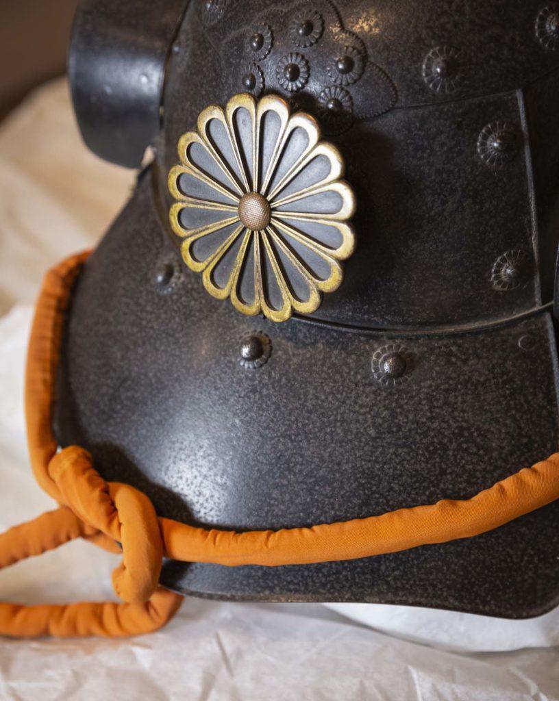 detail of a Japanese lotus design on a Samurai helmet