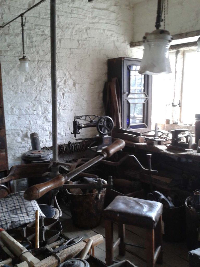 gas lights and burnishing irn in the corner of a workshop