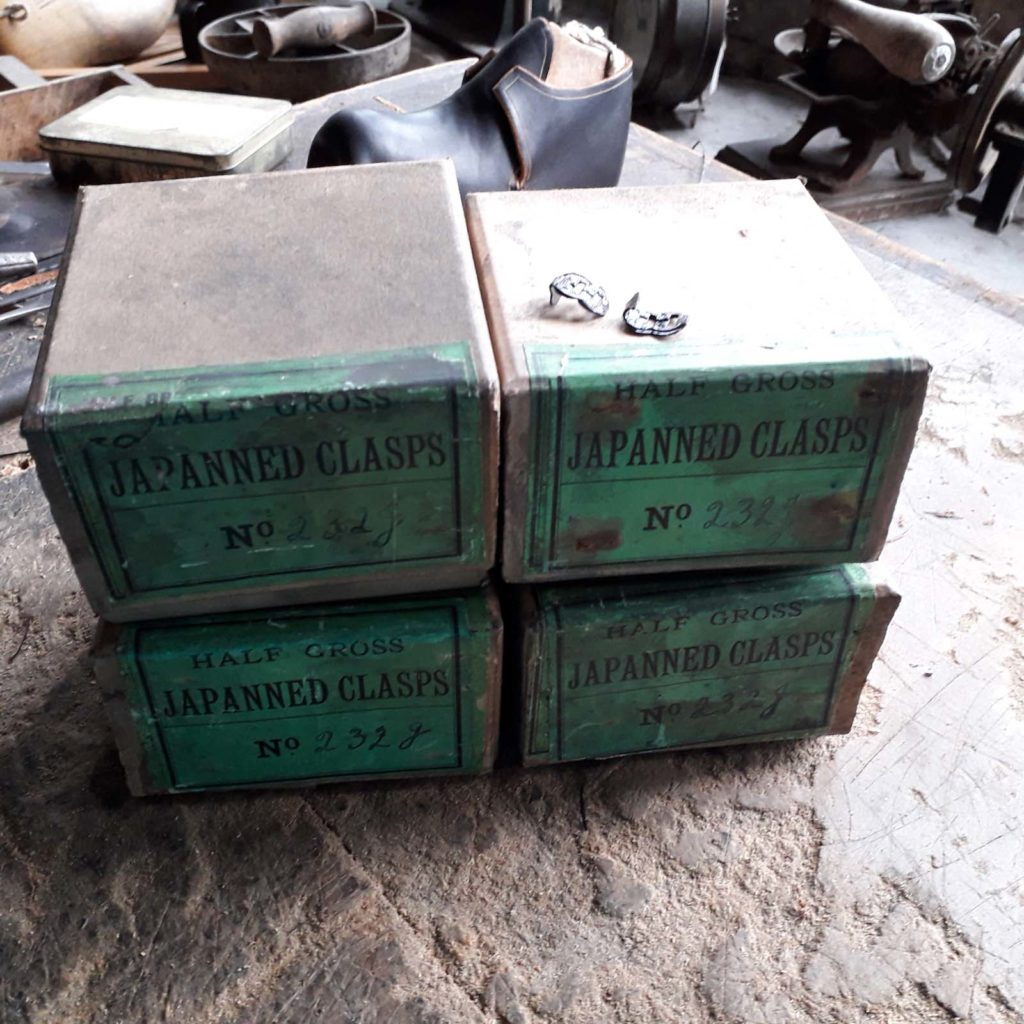 photo of a four green cardboard boxes marked clasps