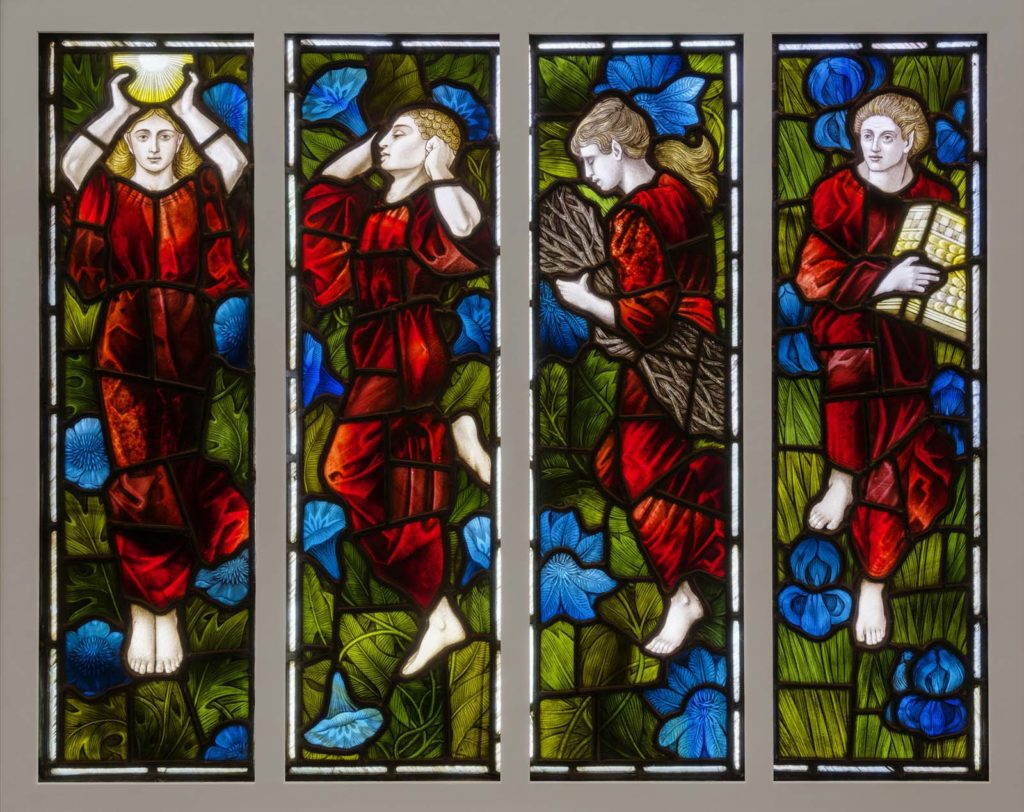 four stained glass panels each featuring a red figure in a red smock