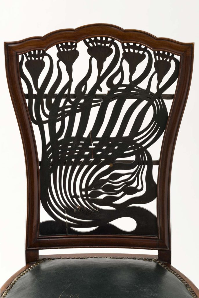 photo of an ornate carved chair back