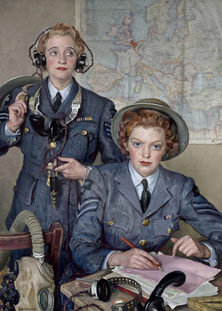 portriat photo of a two women in Royal Air Force uniform and WWII-styled tin hats