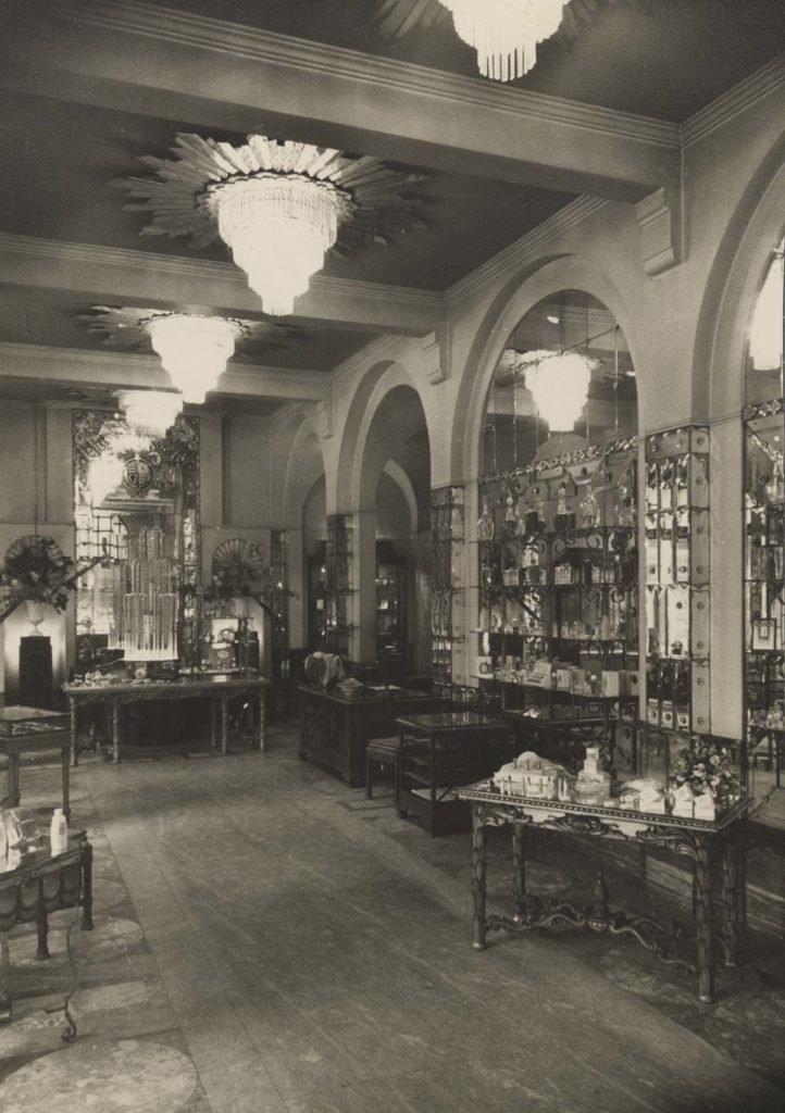 black and white photo of a shop interior with archways tables and uniform lemon shaped lampshades