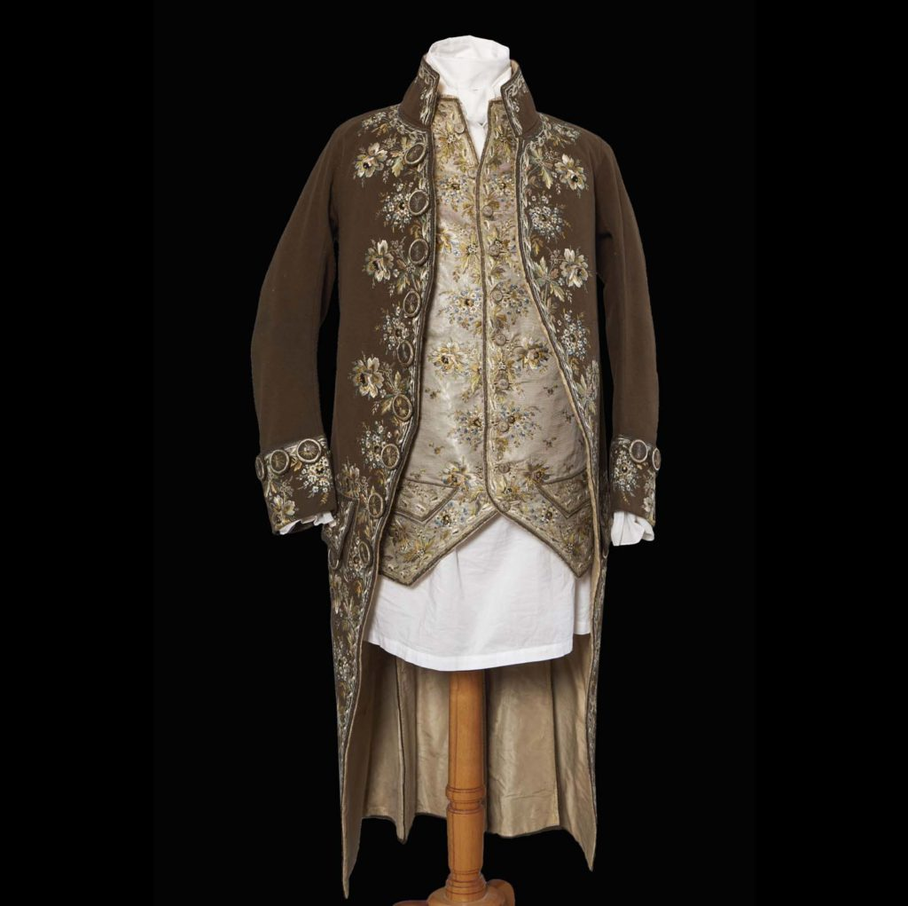 photo of a tailcoat and waistcoat on a display mannequin