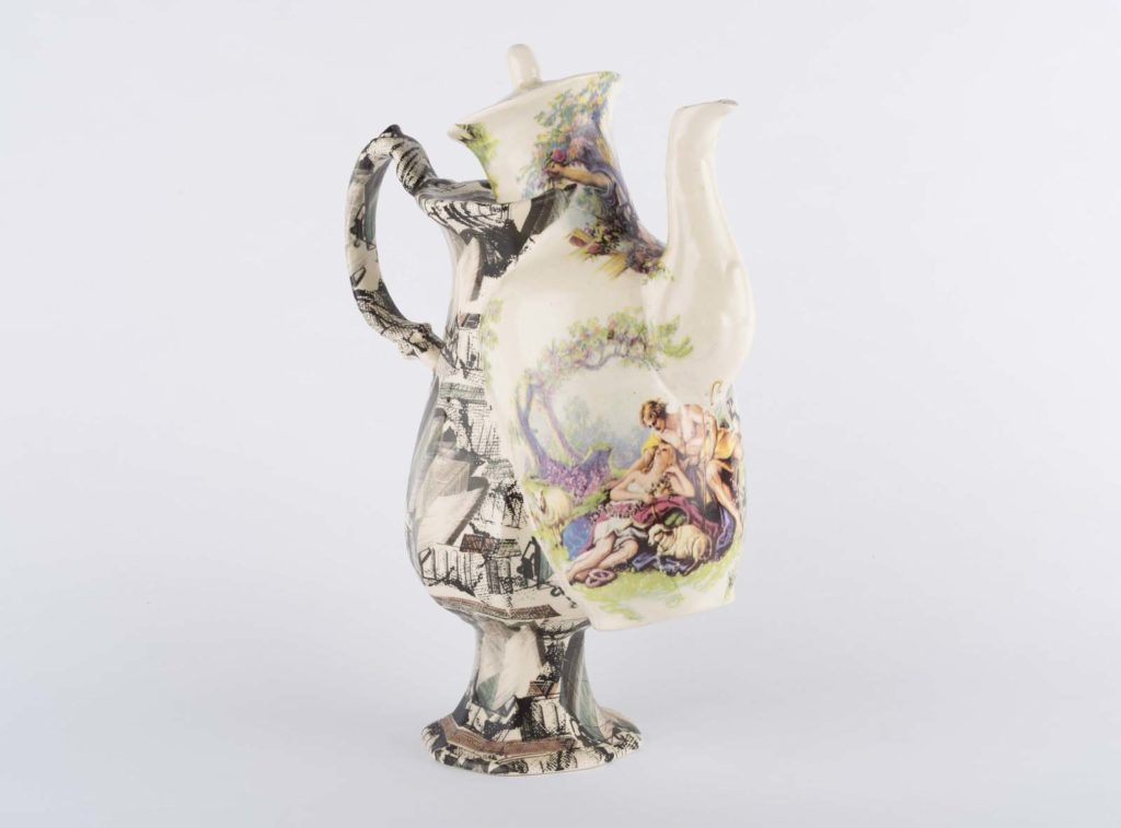 a strange teapot with a baroque design supplanted over a modernist pot on a single stand
