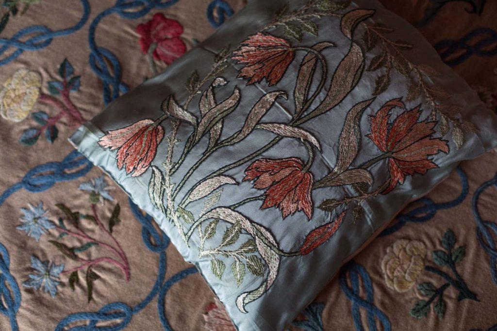 a photo of a floral design silk cushion