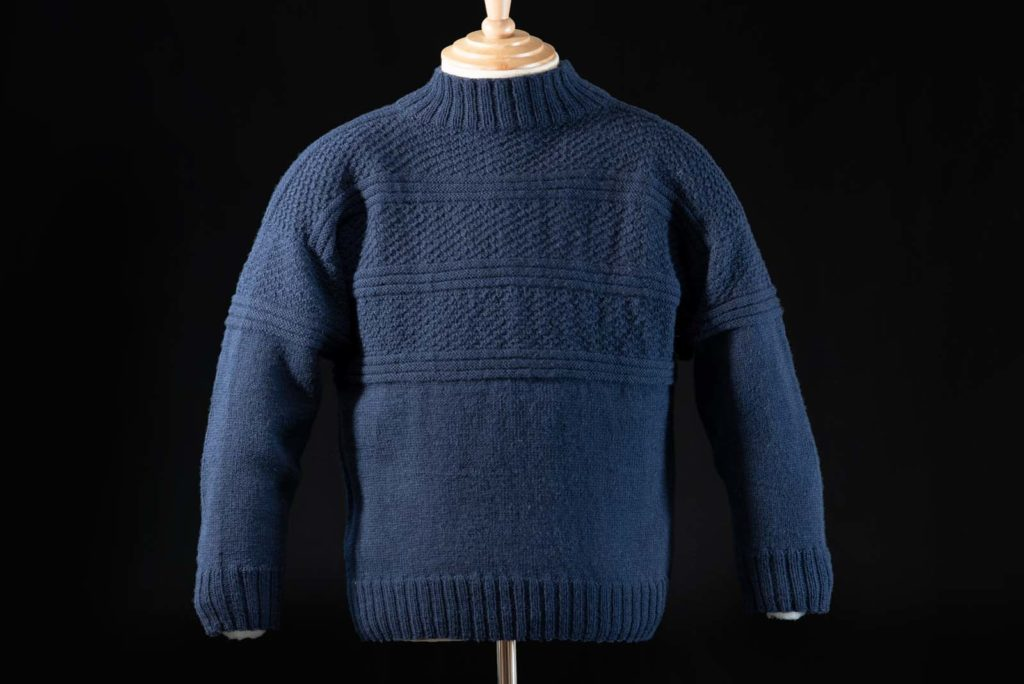 photo of a blue fishermen's sweater on a mannequin