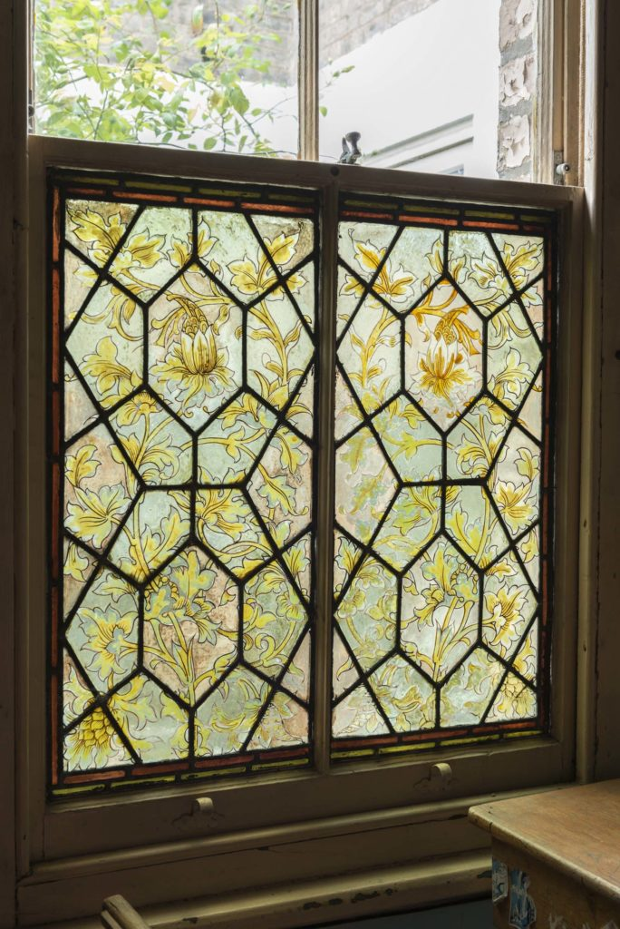 photo of a green stained glass sash window