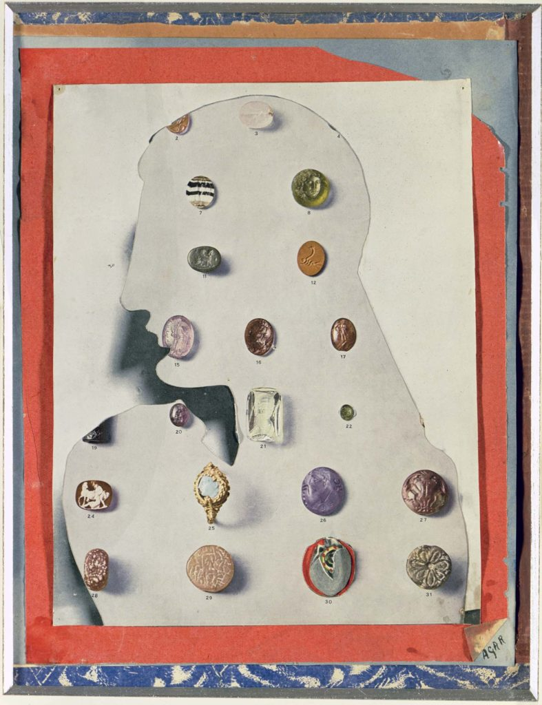 collage of consisting of a silhouette with stones and intaglios affixed to it