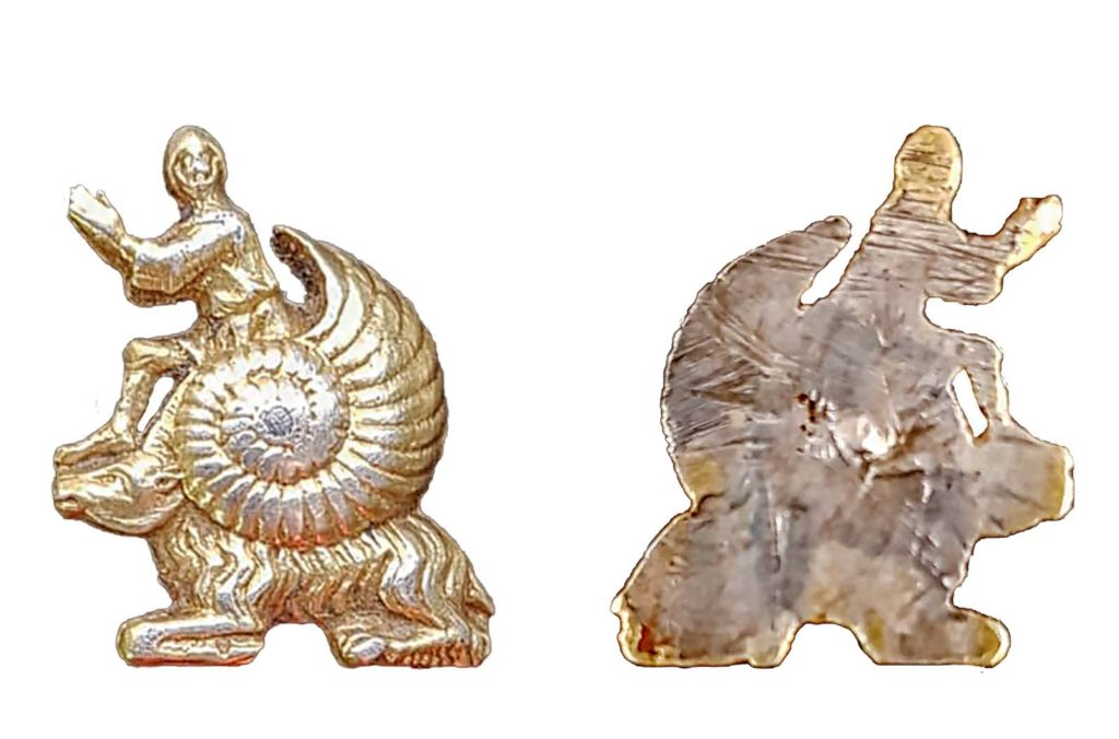 photo of two side of a small pendant of a man riding a snail