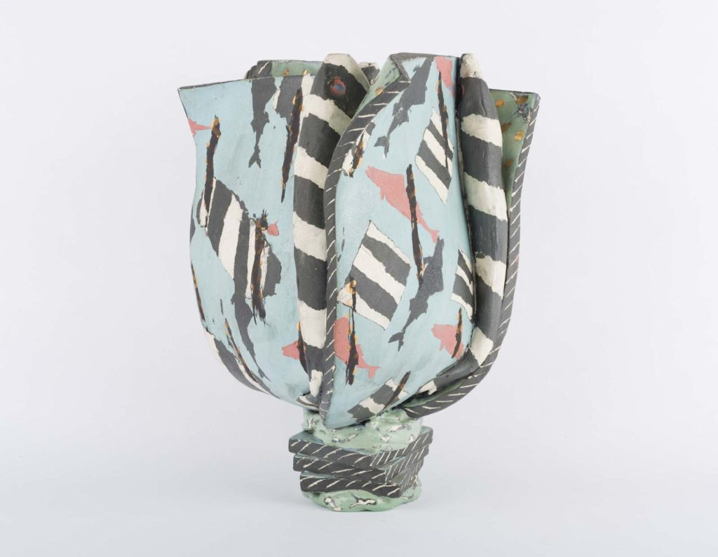 abstract flat vase with tulip shape and light blue with with black and white motifs