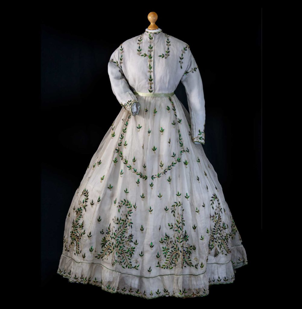photo of a nineteeenth century dress in linen with a floral pattern