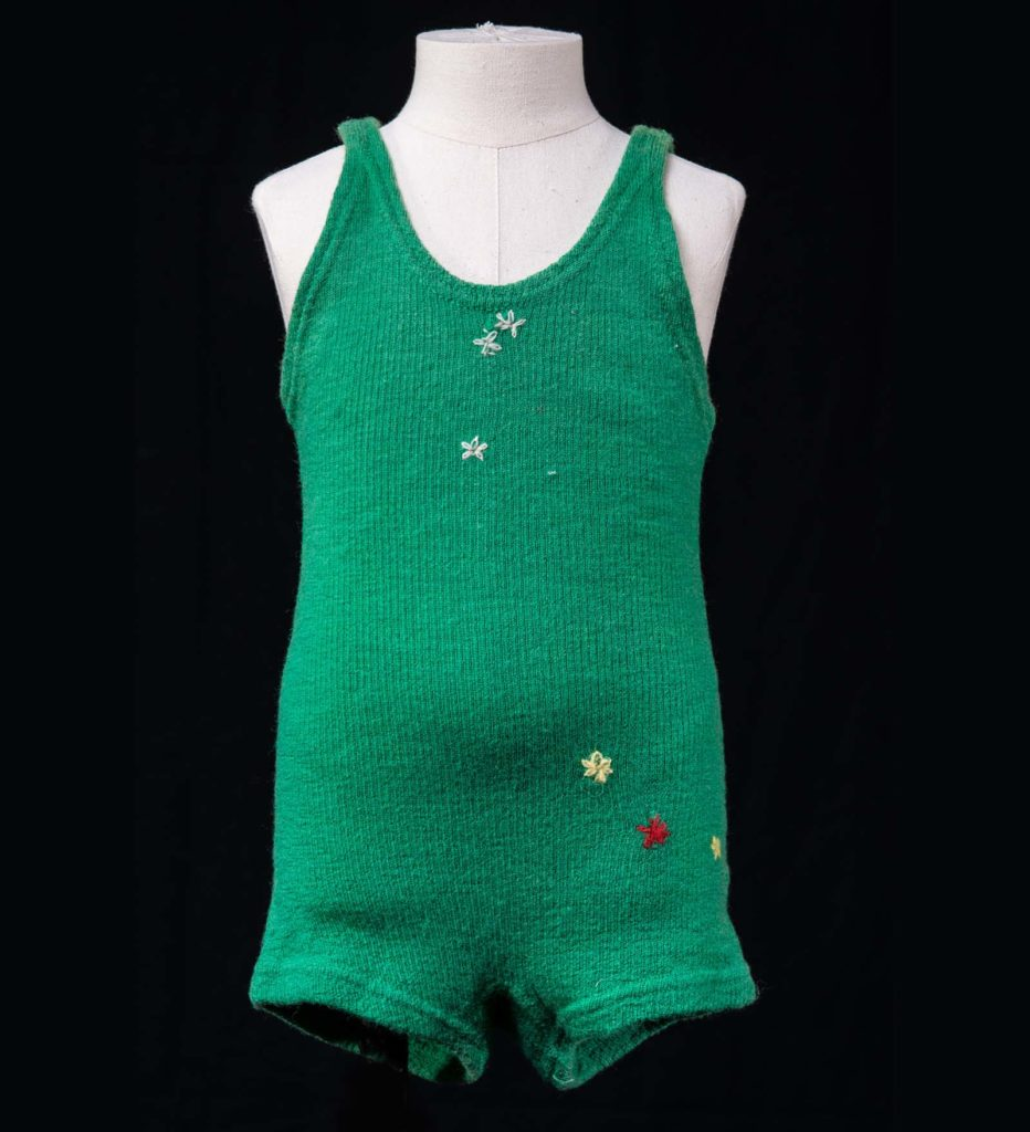 green kitted one piece swimming costume with trunks and shoulder loopsme with