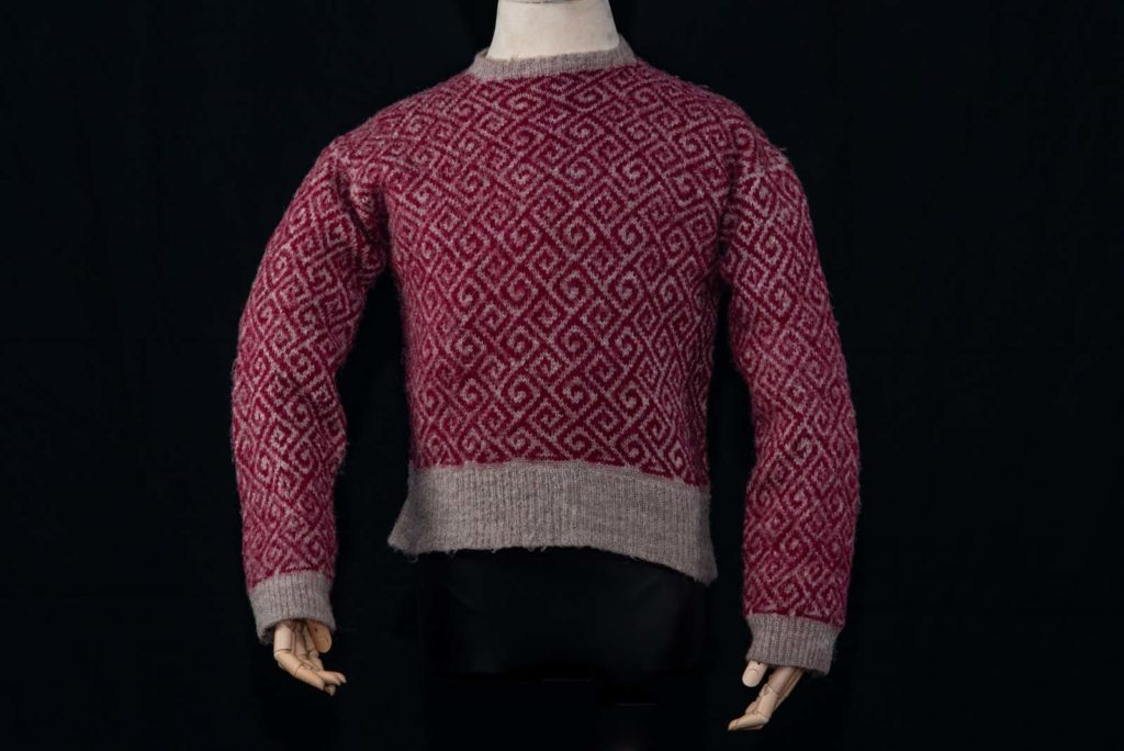 photo of a knitted jumper in purple