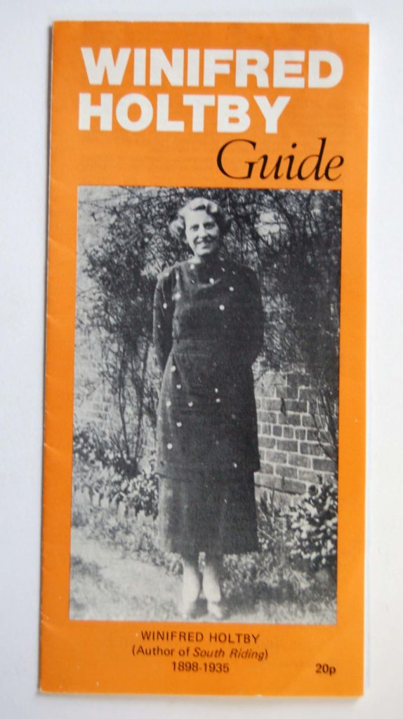fold out paper guide with photograph of a woman on the cover