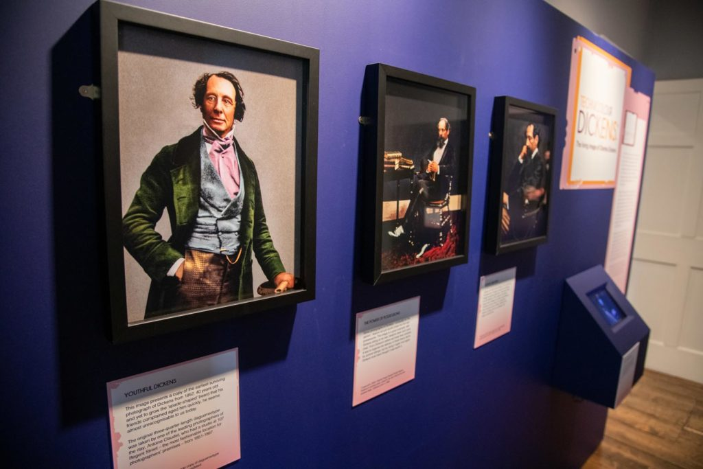 photo of photographic portraits on a gallery wall