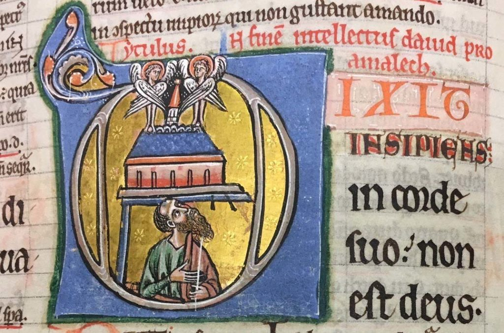 illuminated manuscript page with central bearded figure