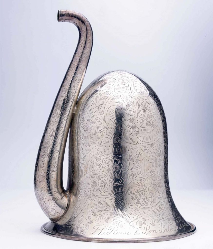 an engraved trumpet like device with bell and spout