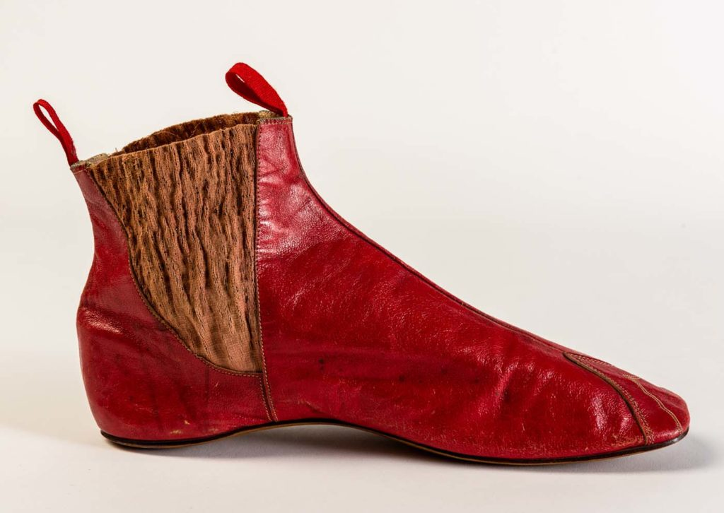 red leather chelsea stule boot with an elasticated side