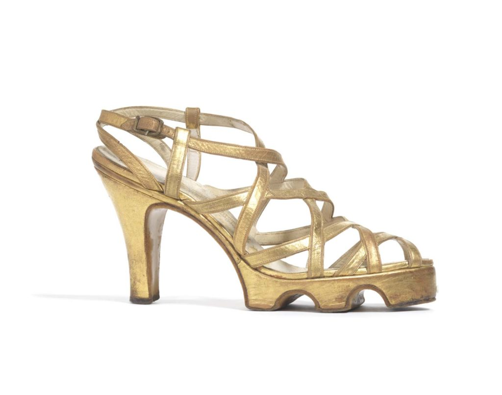 a high heeled open toe sandal in gold