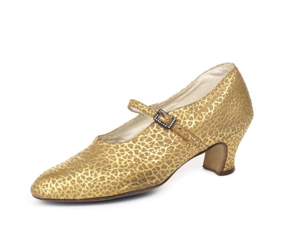 a mottled gold high heel shoe