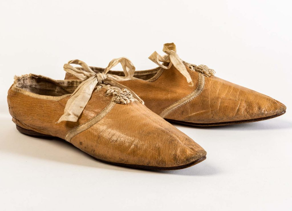 pair of soft tan shoes with simple lace up