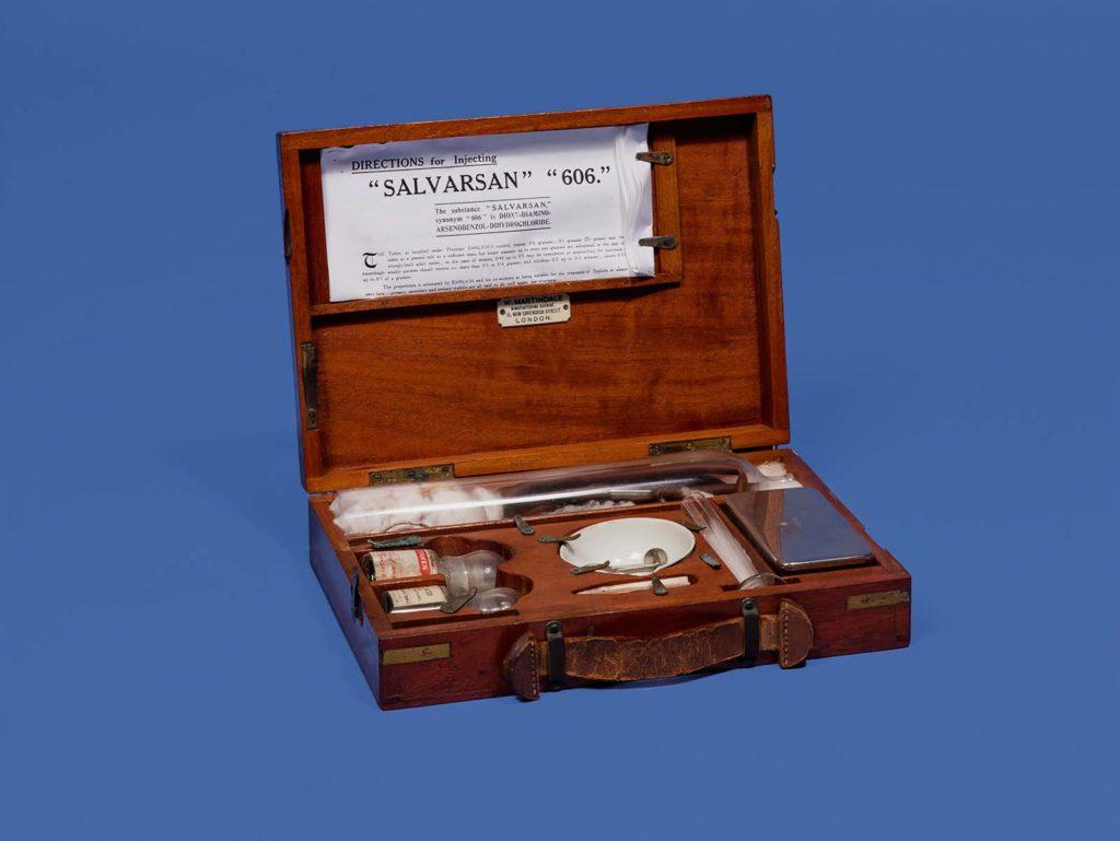 photo of an open wodeen box with medical kit inside